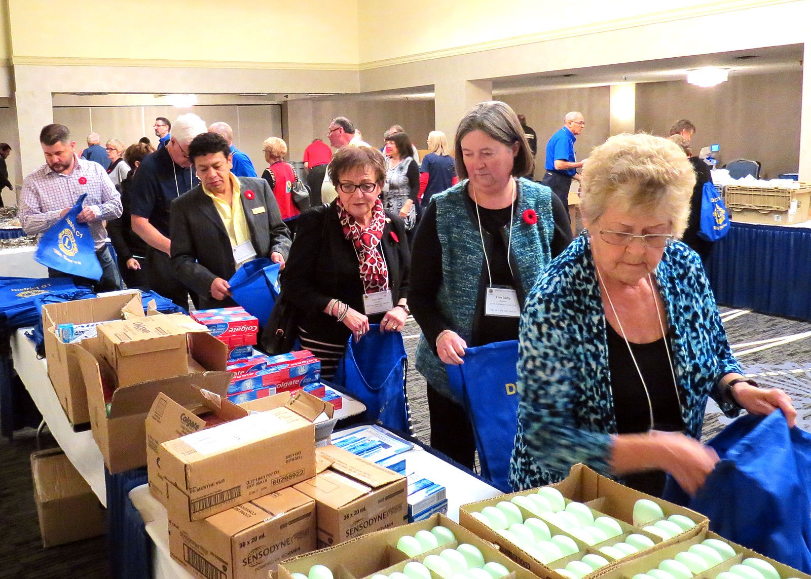 Lions stuffing bags with personal supplies for women's shelters | Nov 2017