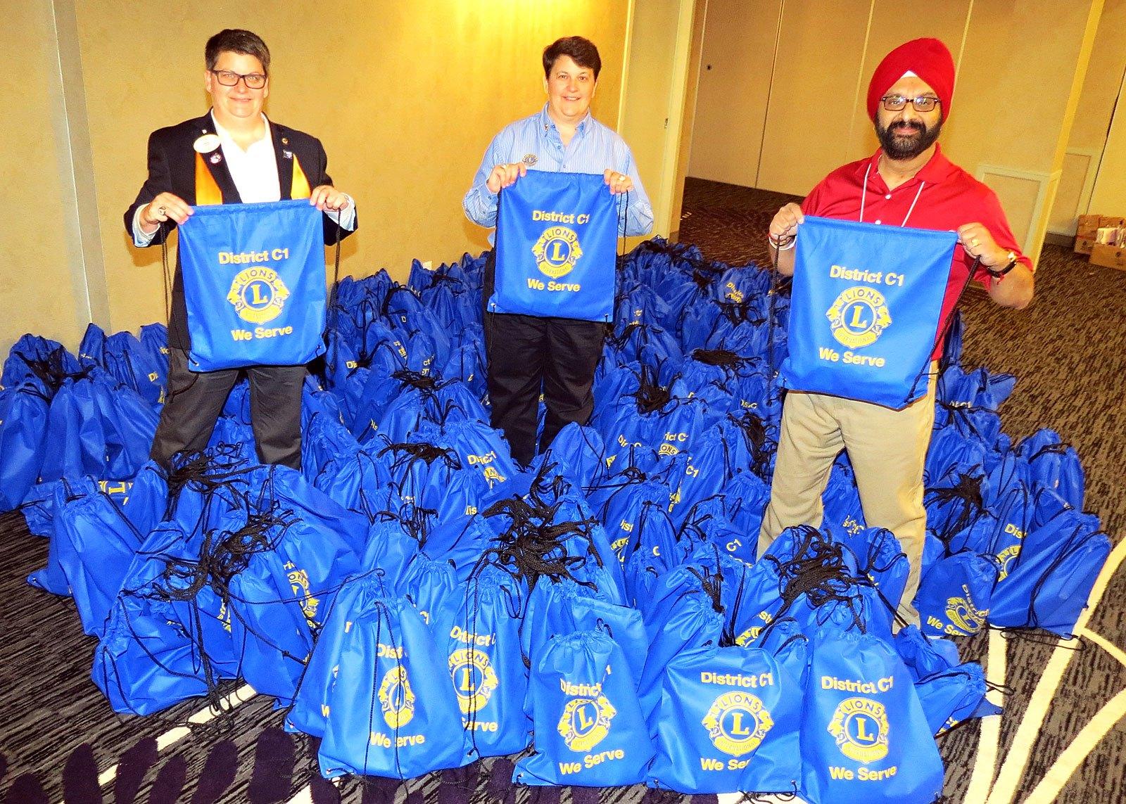 "[l to r] DG Kriz Kozoriz; Southgate Club President Patti Liogier; South Edmonton 2nd VDG-elect Chanprit ""Prince"" Baweja with 509 bags of supplies for women's shelters | Nov 2017"